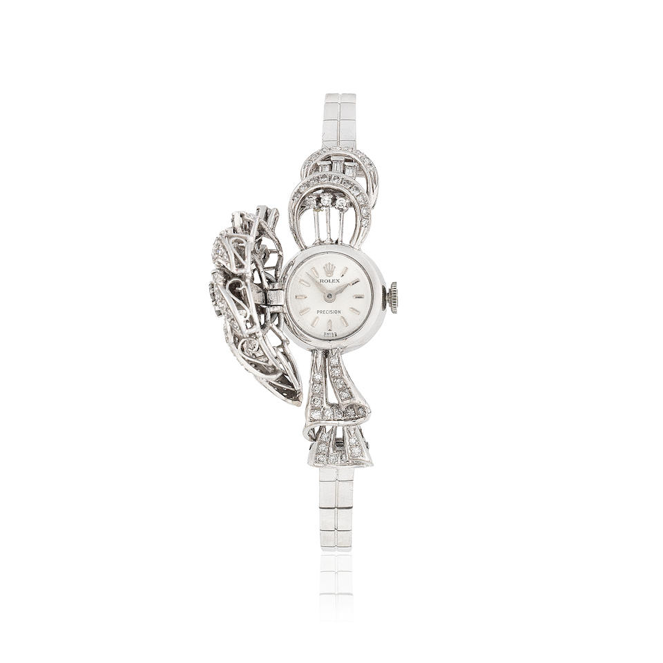 Rolex. A lady's 18K white gold and diamond set manual wind bracelet watch with concealed dial  Precision, Ref: 2179, Circa 1960