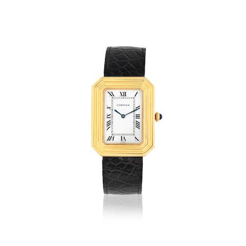 Cartier. An 18K gold manual wind rectangular form wristwatch with canted corners Circa 1990