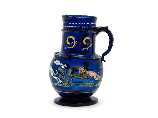 A Bohemian Enamelled cobalt blue glass jug, dated 1599