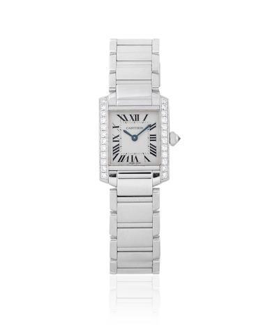 Cartier. A lady's 18K white gold and diamond set quartz bracelet watch  Tank Française, Ref: 2403, Circa 2005