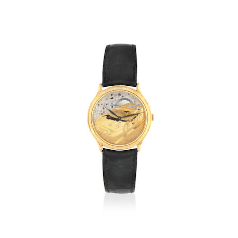 Audemars Piguet. An 18K gold automatic semi-skeletonised motoring themed wristwatch Circa 1990