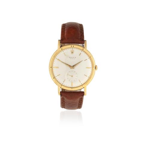 Rolex. An 18K gold manual wind wristwatch Circa 1980