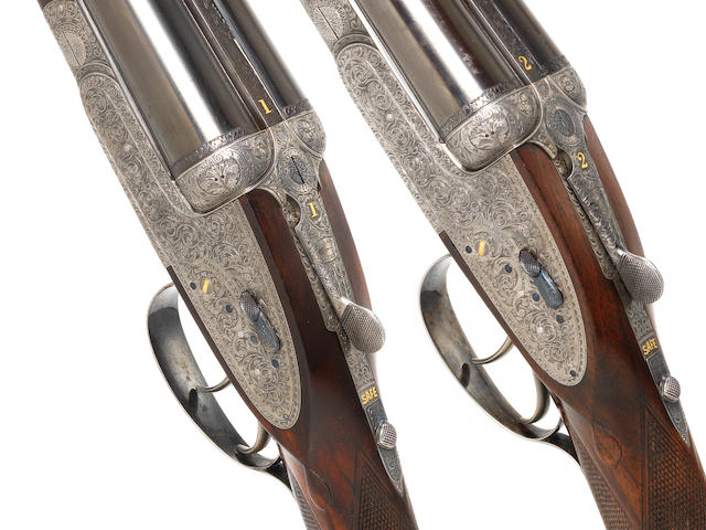 A matched pair of 12-bore 'Royal' sidelock ejector guns by Holland & Holland, no. 27057/27061 In their brass-mounted oak and leather case