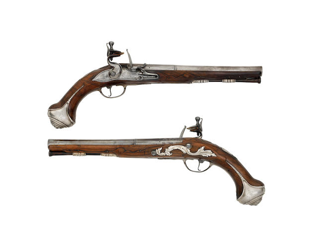 A Rare Pair Of 18-Bore Flintlock Silver-Mounted Holster Pistols (2)