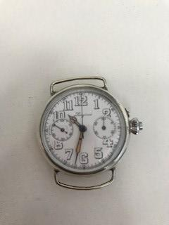 Longines. An early and rare silver manual wind single button chronograph wristwatch Circa 1915