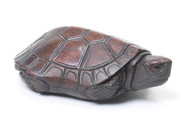 A kurogaki (black persimmon) wood netsuke of a tortoise Iwami Province, late 18th/early 19th century