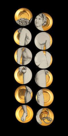 Piero Fornasetti (Italian, 1913-1988) Eve: A Set of Twelve Dinner Plates, designed circa 1954