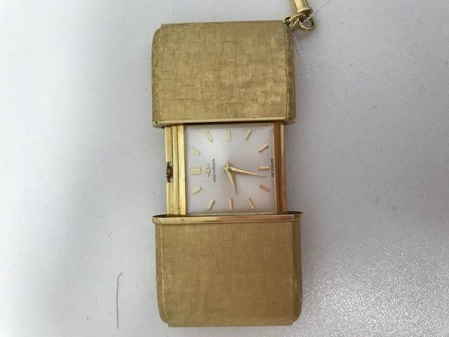 Movado. An 18K gold manual wind purse watch with original box and Certificate Sold 20th November 1961