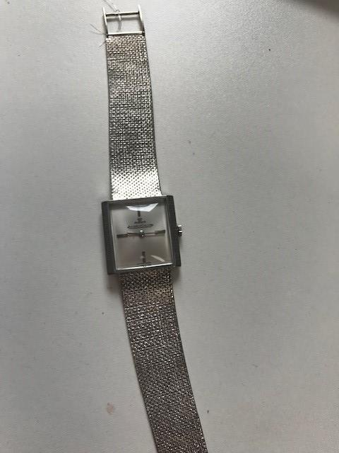 Jaeger-LeCoultre. An 18K white gold manual wind square bracelet watch Ref: 1932, Circa 1952