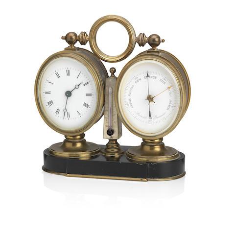 A late 19th century brass desk timepiece compendium