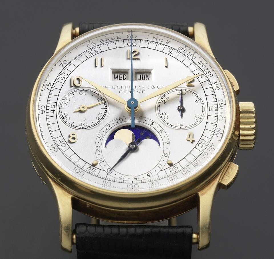 Patek Philippe. A very rare and fine 18K gold manual wind perpetual calendar chronograph wristwatch with moon phase Ref: 1518, Manufactured 1947, Sold April 6th 1948
