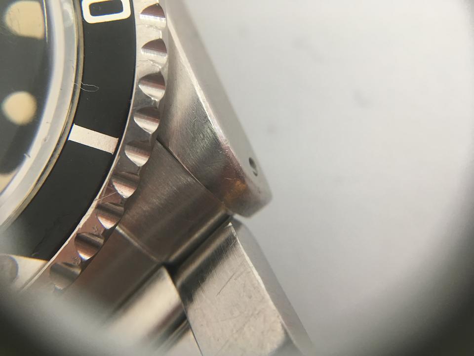 Rolex. A stainless steel automatic calendar bracelet watch  Submariner, Ref: 1680, Circa 1977