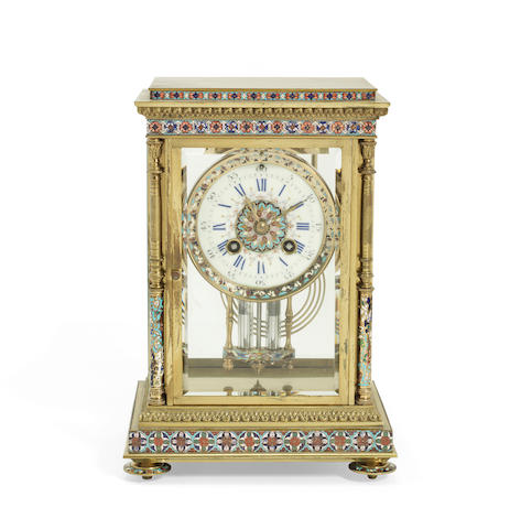 A late 19th century French gilt brass and champleve enamel four glass mantel clock the movement stamped S. Marti & Cie