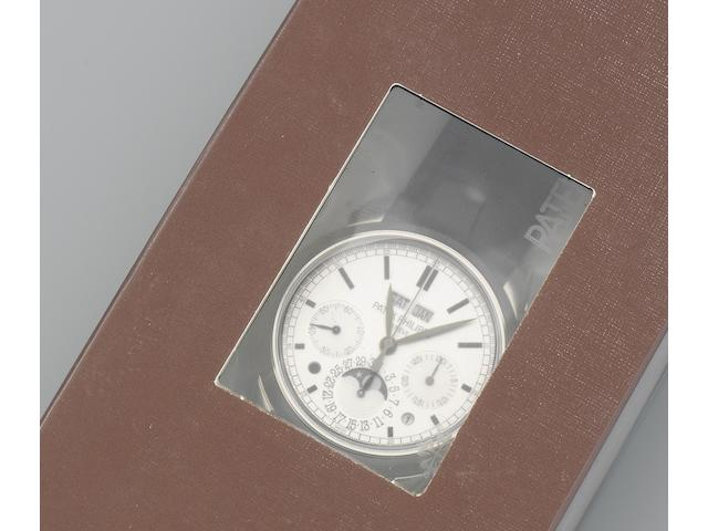 Patek Philippe. A fine and rare double factory sealed 18K white gold manual wind perpetual calendar chronograph wristwatch with moon phase Ref: 5270G-001, Sold 27th July 2012