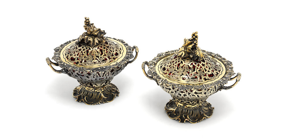 A good pair of Victorian silver-gilt covered vases by Charles Thomas & George Fox, London 1843, one finial by Philip Rundell with George IV duty mark