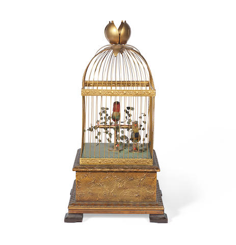 A decorative gilt metal, composition and stained wood caged singing bird automaton in the Victorian style, second half 20th century