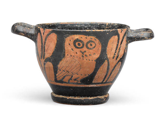 A Greek red-figure owl skyphos