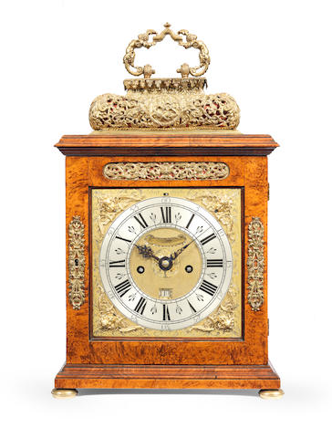 A late 17th century walnut veneered quarter repeating basket top table clock Christopher Gould, London