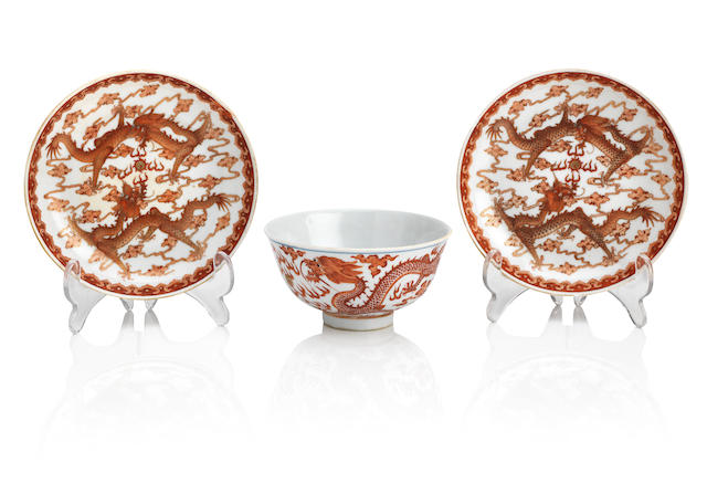 A pair of iron-red and gilt 'two-dragon' dishes and associated bowl The dishes with underglaze blue Guangxu six-character mark