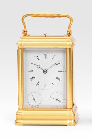 A good grande sonnerie carriage clock with subsidiary date and alarm dials in its orginal travelling case Numbered 2414 3