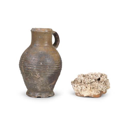 A Rhineland stoneware jug together with an encrusted stoneware shard 15th Century