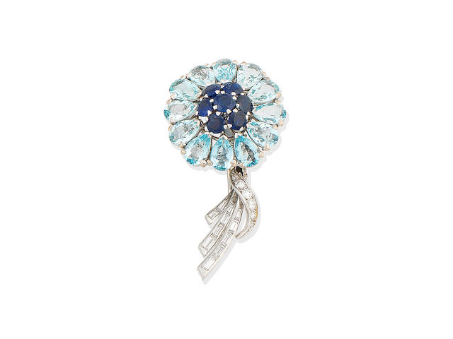 An aquamarine, sapphire and diamond flower brooch, circa 1950