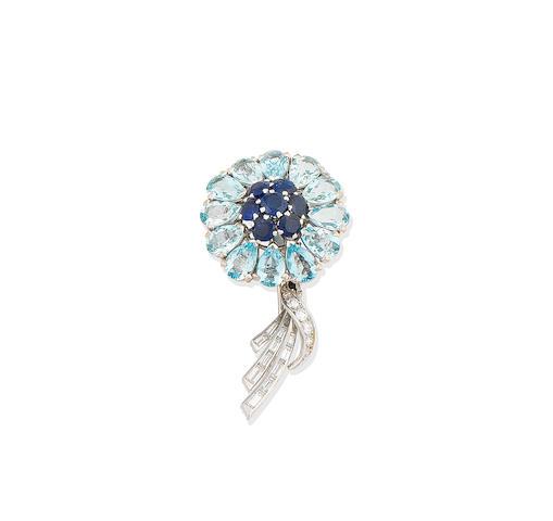 An aquamarine, sapphire and diamond flower brooch, circa 1950