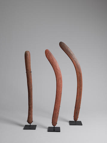 Maker Unknown A pair of boomerangs, Yuendumu and a club, Western Desert, Northern Territory, 1920s-1930s lengths: 62.0cm (24 7/16in)., 64.0cm (25 3/16in)., 74.0cm (29 1/8in).