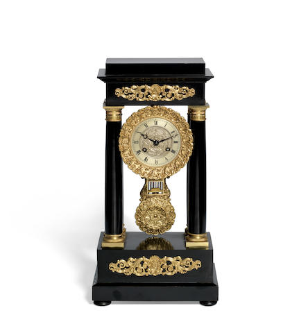 A mid 19th century ebonised and gilt brass French portico clock
