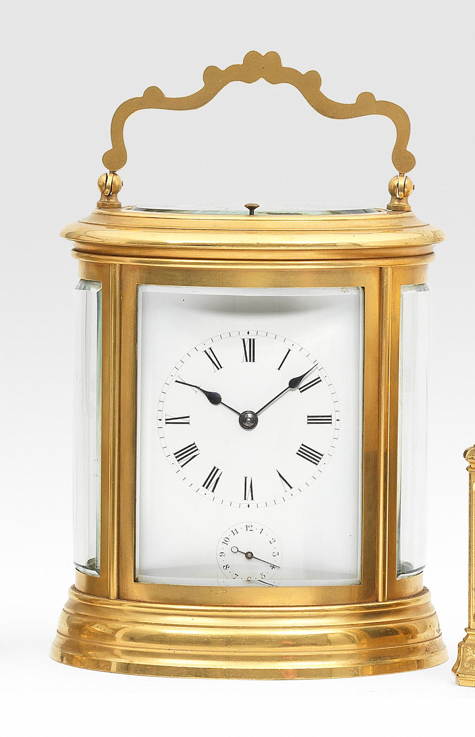 A good late 19th century French gilt brass oval grande-sonnerie striking and repeating carriage clock in original box  The movement numbered 713. 2