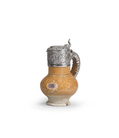 A Cologne/Frechen stoneware silver-mounted jug Late 16th Century
