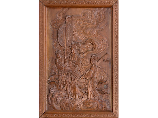 A carved wood panel of Kannon and attendants Meiji Era, late 19th century