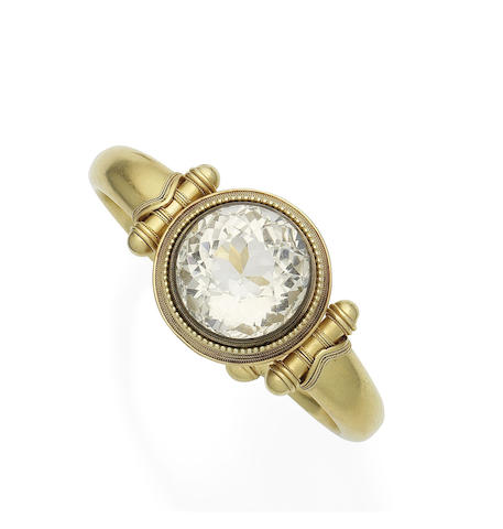 A gold and rock-crystal hinged bangle, by Phillips Brothers,