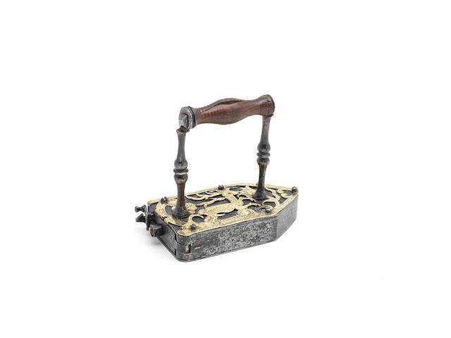 A rare wrought iron and brass box iron, Southern German, circa 1700  (2)