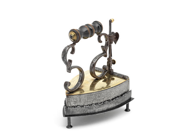 A wrought iron and brass box iron, with stand, Scandinavian, probably Danish, dated 1869  (3)