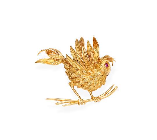 A gold and ruby bird brooch, Boucheron