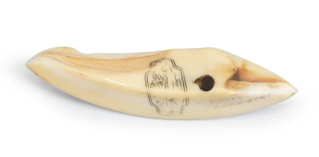 A small boar-tusk netsuke with a landscape and poem