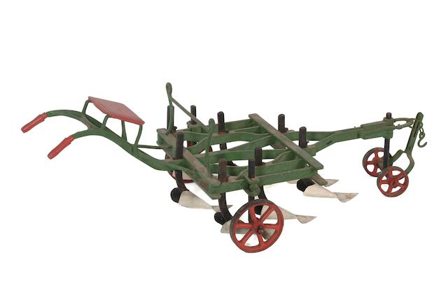 AN AGRICULTURAL SHOW MODEL OF A TASKERS' HOE, circa 1880, accompanied by a foot-operated bellows, Griffin & George Ltd,