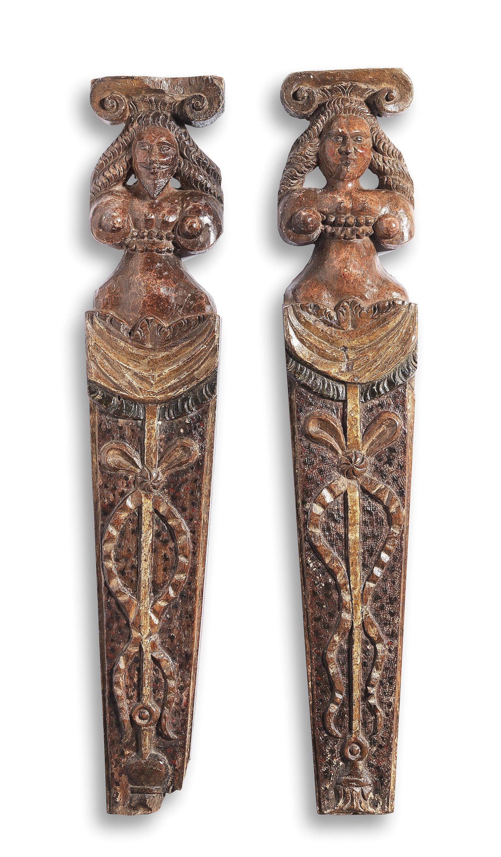 A rare pair of Elizabeth I/James I carved oak and polychrome-decorated...