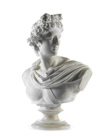 A late 19th/early 20th century Italian carved white marble bust of the Apollo Belvedere after the antique