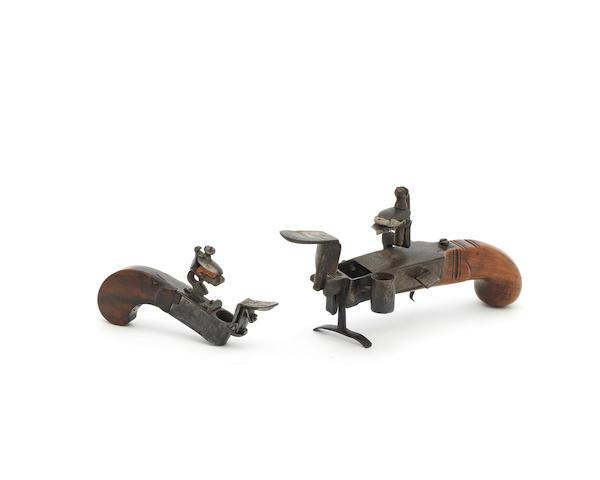 A steel and fruitwood tinder pistol, or table 'strike-a-light', English, circa 1750 Signed 'I. Savige, W'hampton' (2)
