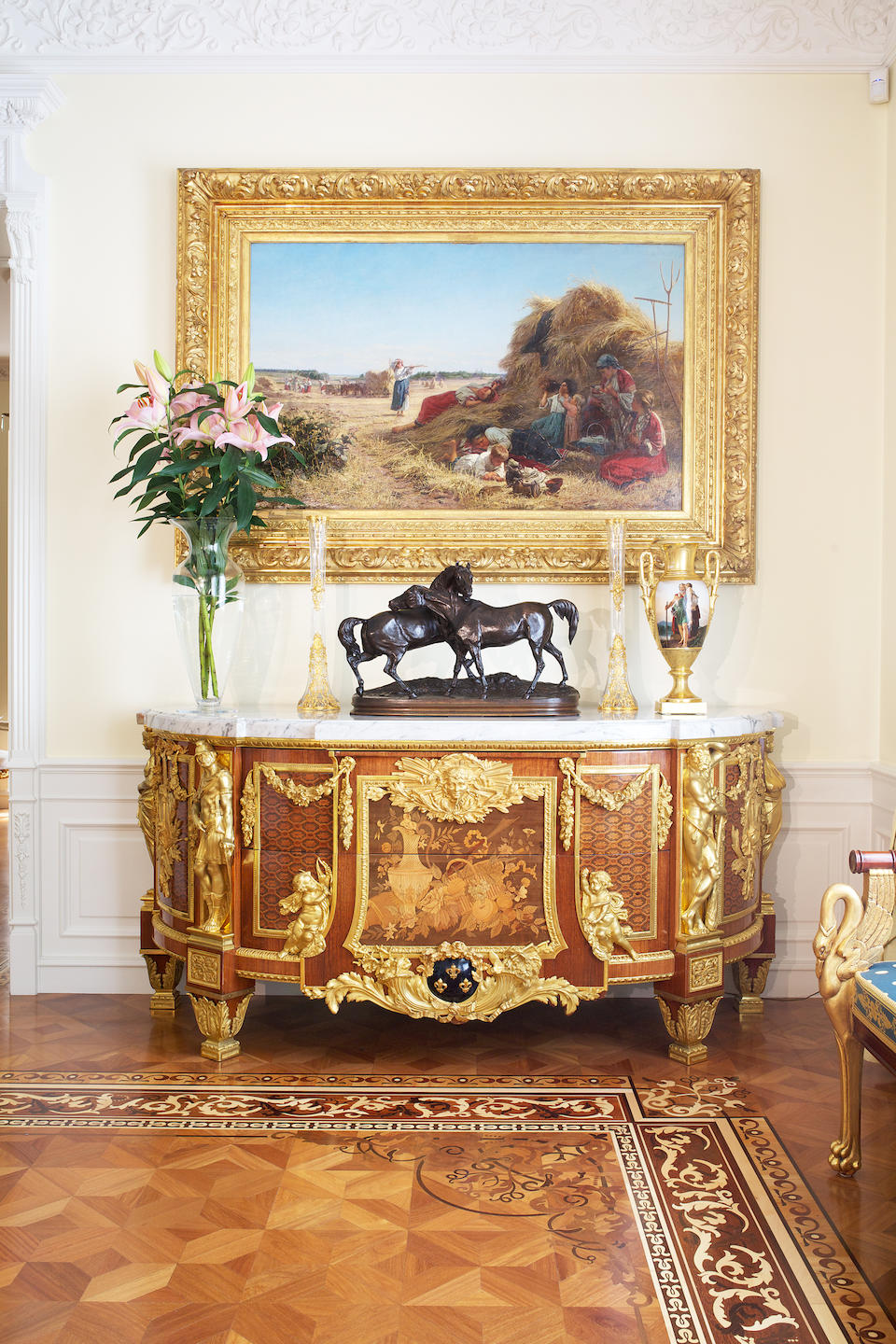 A fine French early 20th century mahogany, fruitwood marquetry and gilt bronze mounted commode in the Louis XVI style, after the original by Jean-Henri Reisener