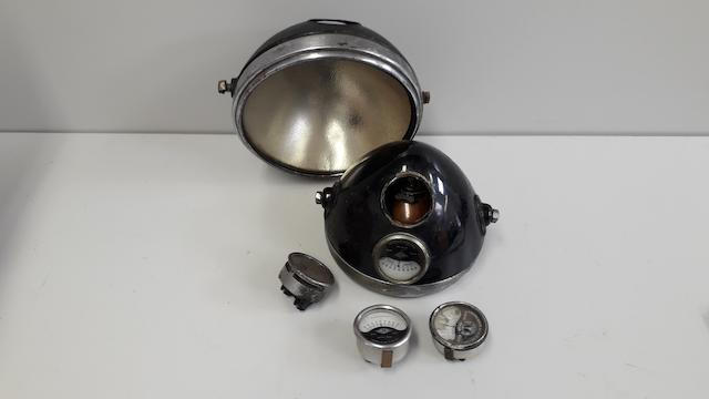 "An original 8"" motorcycle headlamp for restoration"