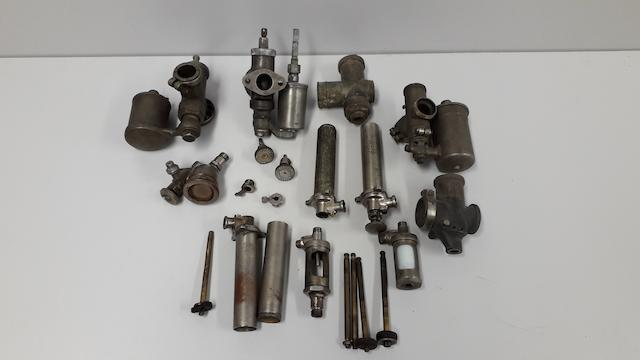 A collection of vintage oil pumps and sight feed parts