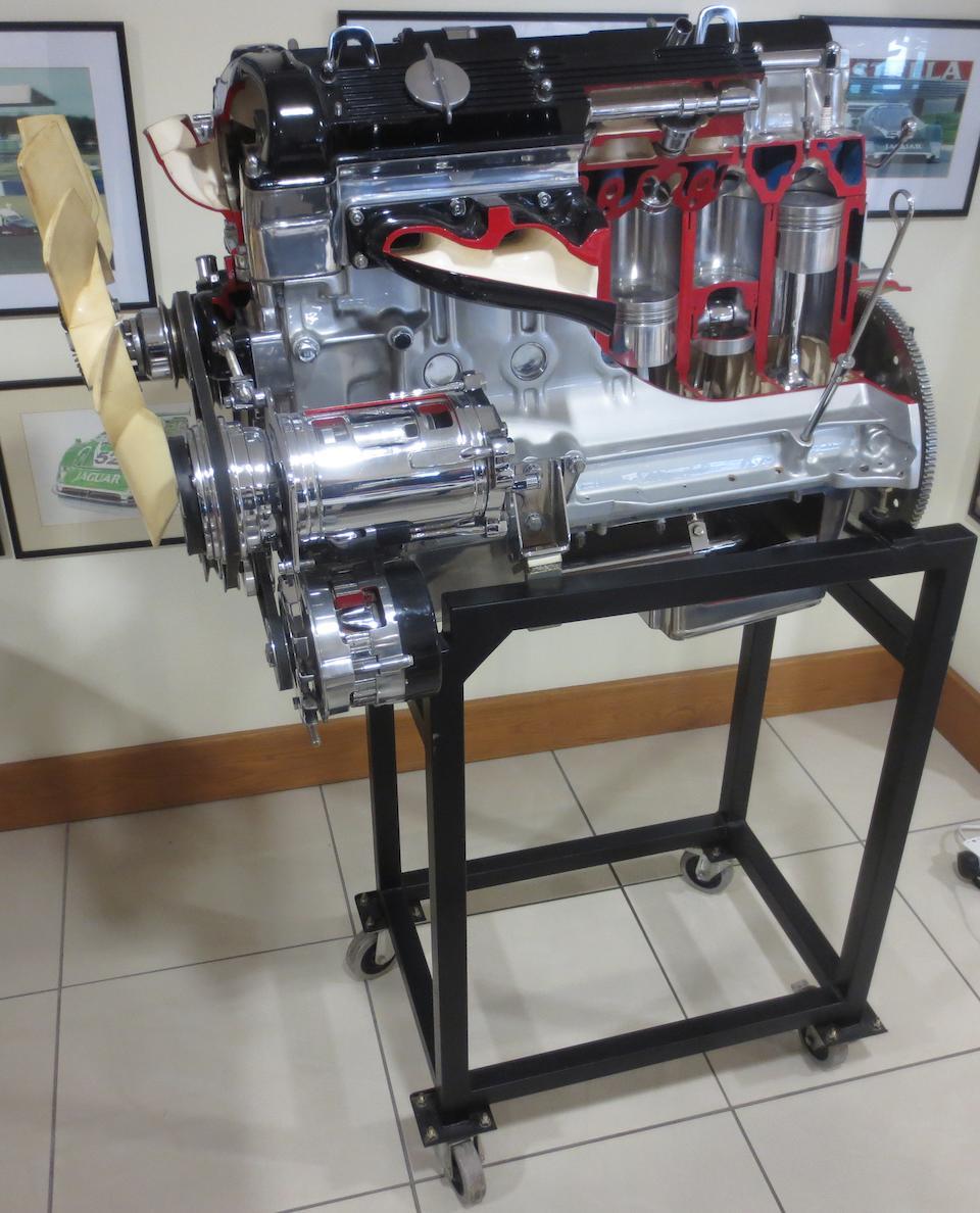 A cut-away 4.2 litre Jaguar 6 cylinder dohc fuel injected engine,
