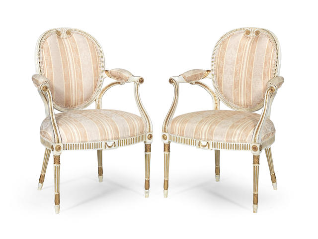 A pair of George III painted and parcel gilt armchairs  (2)