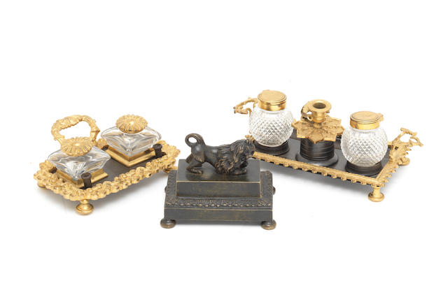 A group of three early 19th century English gilt and patinated bronze encriers