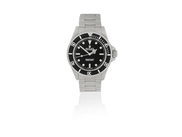 Rolex. A stainless steel automatic calendar bracelet watch  Submariner, Ref: 14060M, Sold June 2002