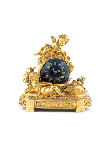 A French 19th century gilt bronze and painted clock In the Louis XVI style