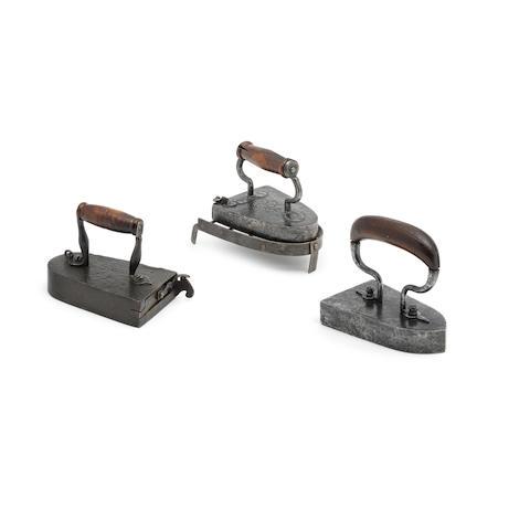 Three 19th century wrought iron box irons, French  (5)